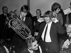 The Beatles in Liverpool, Friday 10th July 1964. Pictured playing with instruments belonging to Police Band, Civil Reception, Town Hall