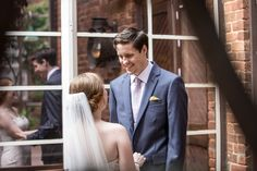 real weddings, wedding photography ideas, first look photos, outdoor weddings, bride and groom, happy couple, window photography, The Historic Brookstown Inn, Winston Salem