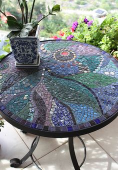 mosaic table; trying to get ideas for how to salvage an ugly old cement table in my lawn