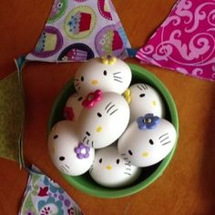 can paint rocks like this too for use in centerpieces; glue rocks to sticks or wooden skewers......Hello Kitty hard boiled eggs.