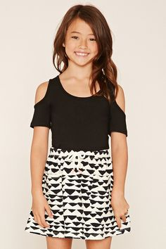 Forever 21 Girls - A knit mini skirt featuring an allover geo print, an elasticized waist with a self-tie spiral thread accent with contrast tips, and twin front patch pockets.