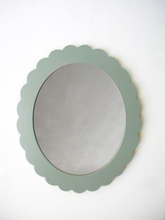The scalloped edge makes this wood-frame mirror a real looker. #etsy