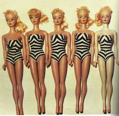 Original Barbie.... Hoping to find time/fabric to make this swimsuit myself one of these summers...!