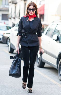 A belted blazer is worn with corduroy flares, lace-up heels, a bandana, and a black woven bucket bag