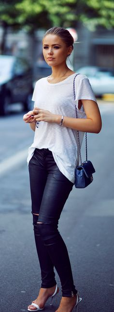 Kristina Bazan is wearing a top from Rag & Bone, trousers from Anine Bing, shoes from Alexander Wang and a bag from Chanel