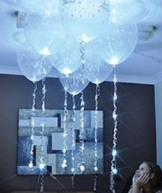 Balloons with ribbon lights.