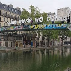 Take and share a 'who made my clothes?' photo in an iconic place: 'Thank you @fash_rev_france for asking #whomademyclothes in Canal Saint Martin in Paris.'
