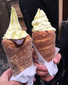 These are from Prague and are called trdelníks. Here we in the US we call them Chimney Cakes. They can be filled with anything. Here they are filled with soft serve ice cream with fudge syrup inside the cone. They look super yummy!