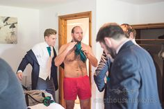 Groom in red boxers forgets to put on his clothes on wedding morning in Dorset. Photography by one thousand words wedding photographers