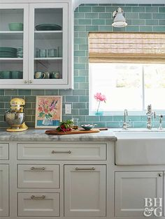 Use these easy kitchen decorating ideas to refresh your kitchen without an extensive remodel. You can do a DIY kitchen makeover in a weekend without breaking the bank. White Kitchen Cabinets, Kitchen Tiles, Kitchen Colors, Kitchen Flooring, Kitchen Decor, Kitchen Wood, Kitchen White, Green Cabinets, Kitchen Counters