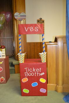 """Ticket Booth I made for this year's VBS """"It's a Blue Ribbon Life: A Study of the Fruit of the Spirit"""".  Covered a box in wrapping paper, cut the letters out with my Silhouette Cameo, and used old wrapping paper cardboard rolls for the top. #carnival #vbs #itsablueribbonlife"""