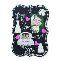 Create your own Memo Board with colorful magnets and favorite photos. Change out photos and magnets year round to create a unique display for all occasions. Add captions to your photos on this chalkboard surface. Wedding and Heart Magnets from Embellish Your Story by Roeda.
