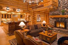 log home-love the view of the great room from the kitchen.