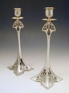 Pinning here because these belong in Rivendell. Description: Pair of silver plate on pewter candlesticks with Art Nouveau floral decoration. Country of Manufacture: Germany. Date: Circa 1906 Jugendstil Design, Art Nouveau Design, Art Deco Furniture, Belle Photo, Art And Architecture, Decorative Objects, Antique Silver, Antique Metal, Candlesticks