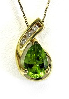 Ladies 10kt yellow gold gemstone and diamond pendant. Mounted in pendant is a pear cut peridot and 3 brilliant round cut diamonds weighing approximately .05ct. Pendant come with an 18 inch yellow gold chain.