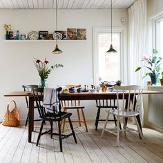 Different colors on the dining table and chairs makes the whole dining area more personal and fun.
