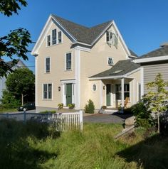 Yellow house for sale in Portland Maine
