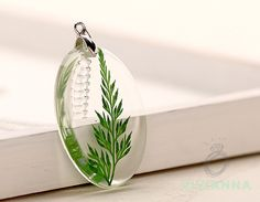 silver and resin pendant with genuine fern