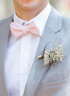 Adorable seersucker bowtie | Photo by: Pasha Belman on Southern Weddings