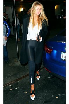 "A chic leggings-based outfit if we've ever seen one. Gigi Hadid's ""birthday suit"" uses a slouchy white tee shirt, black & white pumps, leather leggings and a black blazer to blend chic and cozy into a flawless street style combo"