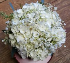 Bridesmaids bouquet. White hydrangeas and gold glitter babys breath. Helen's Flowers in Greenville, OH