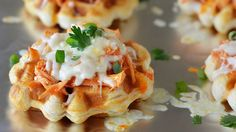 Turn your favorite app into a meal with these golden biscuit-waffles topped with sweet and spicy Buffalo chicken.