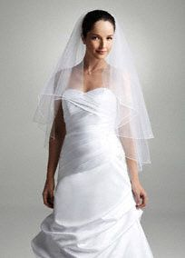 Elegant tiered veil will frame your look beautifully on your special day.  Features two tiers adorned with scattered sequins for extra sparkle.  Imported.  Available in Ivory and White in stores.
