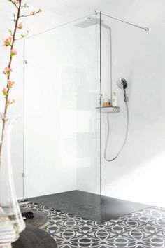 Large open showers with pattern tiling and double headed shower rose- what more could you want?