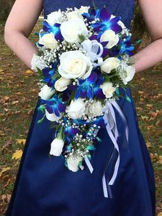 Blue orchid and white rose bridal cascade by Stein Your Florist Co. #Wedding #WeddingWednesday #BridalBouquet