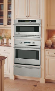 The clean, light color here is great. Love the design around the stove and the backsplash.