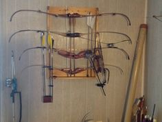 Bow Collection -- Long bow on side wall (out of view), Carp Fishing bow on floor.