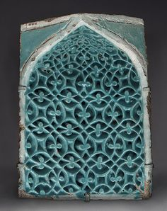 Tile from a squinch, Timurid period (1370–1507), second half of 14th century Present-day Uzbekistan, Samarqand Stonepaste; carved and glazed