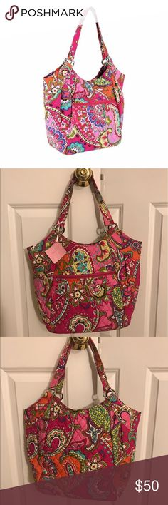 """Vera Bradley Pink Swirls Crescent Handbag Purse Double handles, magnetic snap closure, pleated details, one front zip pocket, flat rectangular base, silvertone hardware Interior lined with contrasting fabric, two back-wall slip pockets Machine wash, line dry Measures approximately 16""""W x 11""""H x 4-1/2""""D with a 10"""" strap drop; weighs approximately 11 oz Shell/lining 100% cotton; fill 100% polyurethane Vera Bradley Bags Shoulder Bags"""