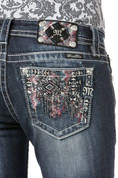 Be extra charming in your Miss Me Metallic Aztec Jeans! The back pockets have metallic silver stitching in an Aztec print with sequins and pink, ivory, and teal stitch accents. The front pockets also