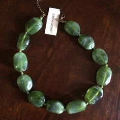 Erica Lyons jade green choker necklace. Jade green stones.  Necklace is choker length and will rest just above or at collarbone. Never worn, still has original price tag from department store. Erica Lyons Jewelry Necklaces