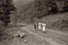 Payday Groceries: September 1938. Miners wives coming home from town with groceries on payday near Mohegan, West Virginia. 35mm nitrate negative by Marion Post Wolcott for the Farm Security Administration.