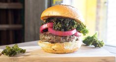 Boom Bar Burger - Blended burgers, which combine ground meat with chopped mushrooms, are gaining in popularity as plant-forward eating continues to trend. At Bareburger, a growing better-burger concept, chef Levin mixes ground boar with fresh oyster mushrooms and white mushrooms, seasoning the blend with ginger and tamari for an Asian accent. A topping of crispy mustard greens, Sriracha vinaigrette and pickled red onions completes the build.