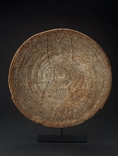 """Lozi Makenge Tree Root Basket - Zambia. 19.5"""" diameter.  Makenge tree roots were gathered from the Malenge bush, boiled until soft and then woven into coil or flat weave baskets. Traditionally, Zambian baskets were marriage gifts. To this day, households use the baskets for winnowing, transporting and storing grain.  www.africaandbeyond.com"""