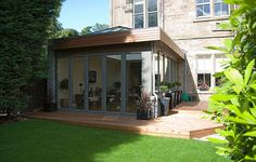 From modern extension ideas and glass boxes to oak frames and brick built additions, find inspiration with our pick of the best contemporary extension designs Orangerie Extension, Extension Veranda, Glass Extension, Roof Extension, Conservatory Extension, Building Extension, Garden Room Extensions, House Extensions, Kitchen Extensions