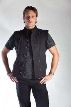 Introducing our Arkana line of mens' vests. The vests feature two pockets on the outside. Our canvas vests are composed of organic cotton lining, and cotton canvas outer shell. All vests are laced up the sides with our custom hand-made ...