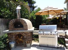 Pizza oven (Forno Bravo clad in McNear Brick), Weber Grill (Summit 670)