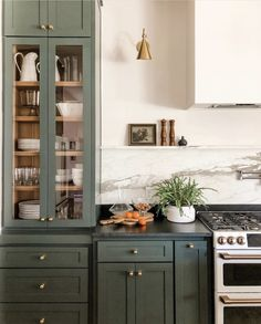 Yay or Nay: Moody Green Interiors – Green cabinets and brass hardware with soapstone counters. – - Yay or Nay: Moody Green Interiors - Green cabinets and brass hardware with soap. Updated Kitchen, New Kitchen, Kitchen Dining, Kitchen Ideas, Eclectic Kitchen, Dining Room, Kitchen Trends, Kitchen Layout, Tudor Kitchen