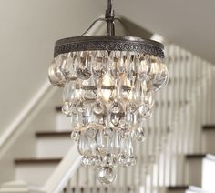 CLARISSA GLASS DROP SMALL CHANDELIER. Suspended from a filigreed antique-silver crown and draped with oversized glass crystals, our chandelier is designed to fit perfectly in a smaller space.