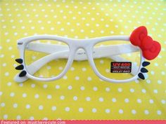 Hello kitty glasses. Looks pretty easy to make.   my guess is: White rimmed glasses, Black & Red Clay.  If you attempt let me know :)