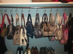 I organized my purses by hanging them  onshower curtain hooks in my closet!