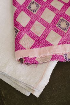 The perfect pop of pink for a room. Antique Chinese Wedding Blanket in fuchsia from Diani Living. More on couldihavethat.com