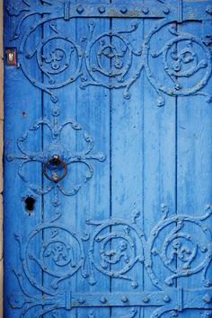 Found in Manchester, wooden blue church gate with decorations Ornate Blue Wood Door