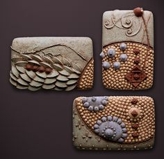 Christopher Gryder  Three ceramic wall tiles formed by carving a dis solvable mold from silt, casting clay within, and excavating days later. Glazed with terra sigillata. Dimensions refer to individual horizontal tiles. Suitable for either interior or exterior installation.