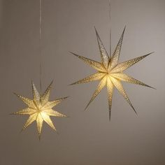One of my favorite discoveries at WorldMarket.com: Silver Glitter 9-Point Star Paper Lantern