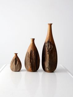A collection of three live edge wood vases. The modernist wooden vessel set feature three graduated sizes with complimenting shapes. - 3 vases - live edge wood CONDITION In great condition with wear c Gypsy Home Decor, India Home Decor, Gold Home Decor, Home Decor Store, Handmade Home Decor, Cheap Home Decor, Elephant Home Decor, Home Decor Catalogs, Wood Vase